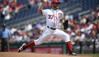 Washington Nationals starting pitcher Stephen Strasburg delivers a pitch during a baseball game against the Los Angeles Dodgers, Sunday, July 28, 2019, in Washington. (AP Photo/Nick Wass) ** FILE **