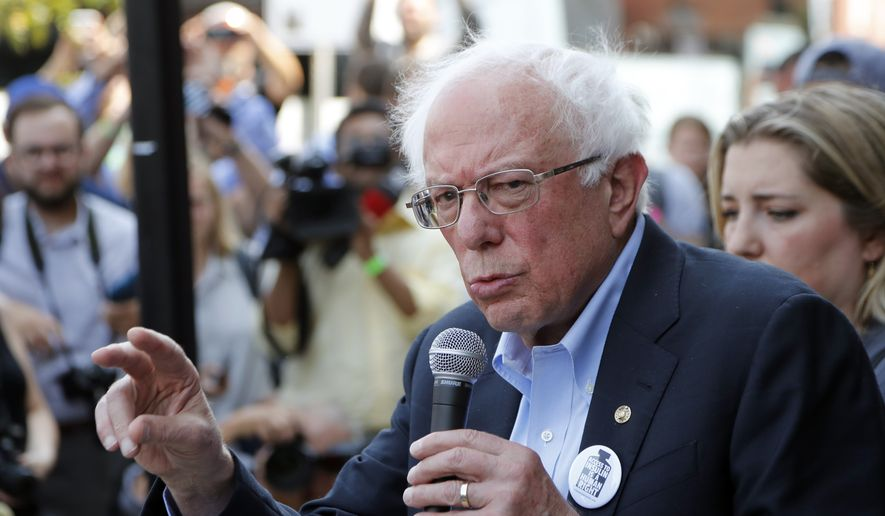 Democratic presidential candidate, Sen. Bernie Sanders, I-Vt., addresses the media outside the Olde Walkersville Pharmacy, Sunday, July 28, 2019, in Windsor, Ont. Sanders and a busload of insulin patients stopped in Windsor to purchase the drug to highlight the high costs of the insulin in the United States. (AP Photo/Carlos Osorio)