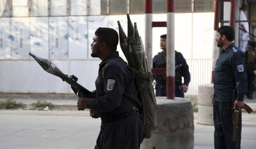 Afghan security personnel stand guard at the site of a deadly attack in Kabul, Afghanistan, Sunday, July 28, 2019. Afghan officials say the political offices of the president's running mate were hit by a large explosion and stormed by an unknown number of attackers. Nasrat Rahimi, the interior ministry spokesman, said vice-presidential candidate and former intelligence chief Amrullah Saleh survived the attack. (AP Photo/Rahmat Gul)