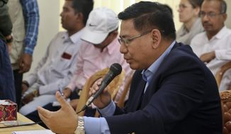 Myanmar's permanent foreign secretary, U Myint Thu, speaks during a meeting with representatives of Rohingya Muslim refugees in Cox's Bazar, Bangladesh, Sunday, July 28, 2019. Thu, led a 10-member delegation for the weekend talks in refugee camps to discuss creating conditions for the safe repatriation of hundreds of thousands of Rohingya Muslim refugees in Bangladesh, officials said Sunday. (AP Photo/Suzauddin Rubel)