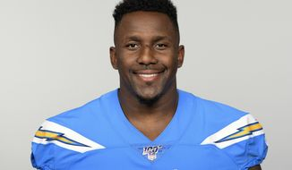 FILE - In this June 10, 2019, file photo, Los Angeles Chargers' Thomas Davis poses in Costa Mesa, Calif. The 36-year old linebacker, who was the one of the few additions the Chargers made during free agency, is already making an impression during the early stages of training camp. Davis inked a two-year deal with the Chargers after spending 14 seasons with Carolina. (AP Photo/File)