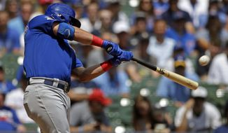 Chicago Cubs' Kyle Schwarber hits a grand slam during the second inning of baseball game against the Milwaukee Brewers Sunday, July 28, 2019, in Milwaukee. (AP Photo/Aaron Gash)