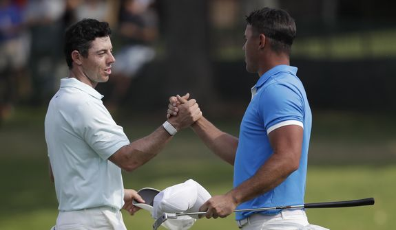 Rory McIlroy, of Northern Ireland, left, shakes hands Brooks Koepka after Koepka won the final round of the World Golf Championships-FedEx St. Jude Invitational, Sunday, July 28, 2019, in Memphis, Tenn. (AP Photo/Mark Humphrey) **FILE**