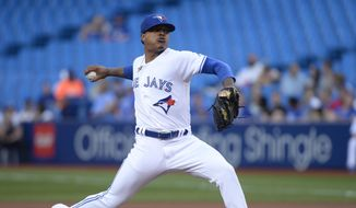 Toronto Blue Jays starting pitcher Marcus Stroman (6) throws against the Cleveland Indians during first inning baseball action in Toronto on Wednesday July 24, 2019. (Nathan Denette/The Canadian Press via AP) **FILE**
