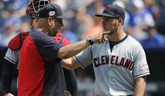 Cleveland Indians manager Terry Francona, left, has words with pitcherTrevor Bauer, right, as Bauer is taken out in the fifth inning of a baseball game against the Kansas City Royals at Kauffman Stadium in Kansas City, Mo., Sunday, July 28, 2019. Bauer threw two baseballs into the stands as he reacted to Royals batter Nicky Lopez's two-RBI single. (AP Photo/Colin E. Braley) **FILE**