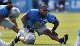 Detroit Lions defensive tackle Mike Daniels (96) stretches during NFL football practice in Allen Park, Mich., Sunday, July 28, 2019. (AP Photo/Paul Sancya)