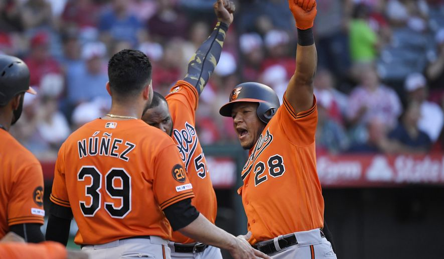 Baltimore Orioles' Pedro Severino, right, celebrates with Renato Nunez, left, and Hanser Alberto after hitting a two-run home run during the third inning of a baseball game against the Los Angeles Angels, Saturday, July 27, 2019, in Anaheim, Calif. (AP Photo/Mark J. Terrill)