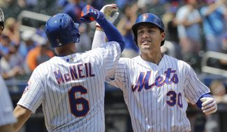New York Mets' Michael Conforto (30) celebrates with teammate Jeff McNeil (6) after hitting a home run during the first inning of a baseball game against the Pittsburgh Pirates, Sunday, July 28, 2019, in New York. (AP Photo/Frank Franklin II)
