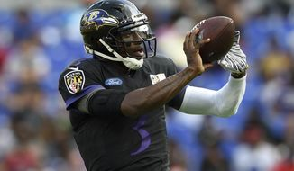 Baltimore Ravens quarterback Robert Griffin III catches a pass during NFL football training camp Saturday, July 27, 2019, in Baltimore. (AP Photo/Gail Burton)
