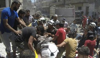 This photo provided by the Syrian Civil Defense White Helmets, shows Syrian White Helmet civil defense workers and civilians carry an injured man on a stretcher after an airstrike hit the northern town of Ariha, in Idlib province, Syria, Sunday, July 28, 2019. Syrian opposition activists and a war monitor say five people have been killed in airstrikes on a town in the country's northwest as the government keeps up its deadly air campaign on the rebel-controlled region. (Syrian Civil Defense White Helmets via AP) **FILE**