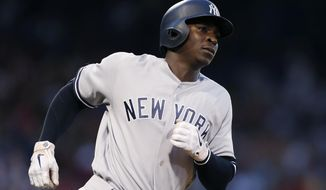New York Yankees' Didi Gregorius runs on his two-run home run during the fourth inning of a baseball game against the Boston Red Sox in Boston, Sunday, July 28, 2019. (AP Photo/Michael Dwyer)