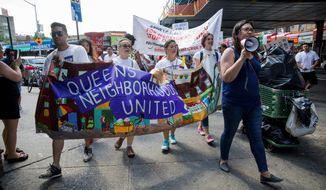 Hundreds of people march in the Queens borough of New York in opposition to the Trump administration's plans to continue with raids to catch illegal immigrants. (Associated Press)