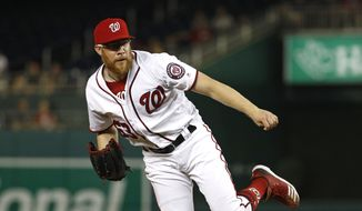Washington Nationals relief pitcher Sean Doolittle follows through on a pitch to the Atlanta Braves in the ninth inning of a baseball game, Monday, July 29, 2019, in Washington. (AP Photo/Patrick Semansky) **FILE**