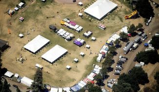 In this aerial photo, vendor booths line Christmas Hill Park, Monday, July 29, 2019, in Gilroy, Calif., the site of a shooting the day before at the Gilroy Garlic Festival. Authorities on Monday were searching for answers to why a 19-year-old opened fire on a popular food festival less than a mile from his parents' home in California, killing two children and another man, but believe many more people would have died if officers patrolling the event had not stopped the gunman so quickly. (AP Photo/Noah Berger)