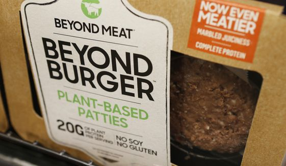 FILE - In this June 27, 2019, file photo a meatless burger patty called Beyond Burger made by Beyond Meat is displayed at a grocery store in Richmond, Va. Beyond Meat reports financial earns Monday, July 29. (AP Photo/Steve Helber, File)