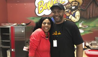 In this July 17, 2019 photo, Denise Anderson and her brother Mike Ford are seen in the a soul food booth they run at the SVRC Marketplace in Saginaw Michigan. Anderson says she hasn't personally seen benefits from the improved economy and she opposes President Donald Trump. Economic conditions in Michigan could be crucial in determining whether Democrats retake a state they once held for decades (AP Photo/Sara Burnett)