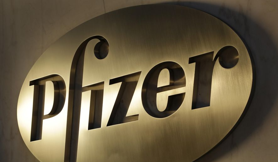 In this Nov. 23, 2015, file photo, the Pfizer logo is displayed at world headquarters in New York. Pfizer is buying Mylan in an all-stock deal and combining the generic pharmaceutical company with its off-patent branded and generic established medicines business. (AP Photo/Mark Lennihan, File)