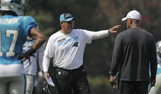 Carolina Panthers head coach Ron Rivera directs his team during practice at the NFL football team's training camp in Spartanburg, S.C., Sunday, July 28, 2019. (AP Photo/Chuck Burton)