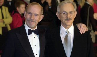 FILE - This Oct. 29, 2002 file photo shows The Smothers Brothers, Tom Smothers, left, and Dick Smothers at the Kennedy Center in Washington for the Mark Twain Prize for Humor Award ceremony honoring Bob Newhart. The duo has stepped out of retirement to commemorate the day 50 years ago when CBS canceled their show over their political impudence. The pair reunited Monday, July 29, 2019, for several appearances at the National Comedy Center in Jamestown, New York. (AP Photo/Lawrence Jackson, File)