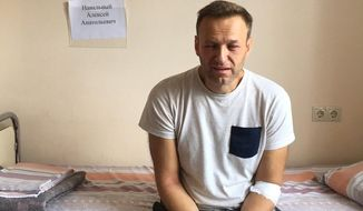 This Monday, July 29, 2019 handout photo released by navalny.com shows Alexei Navalny, Russia's most prominent opposition figure, sitting on a bed in a hospital, in Moscow, Russia. Russian opposition leader Alexei Navalny was discharged from a hospital Monday even though his physician raised suspicions of a possible poisoning after he suffered facial swelling and a rash while in jail. (navalny.com via AP)