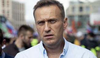 FILE - In this Saturday, July 20, 2019, file photo, Russian opposition leader Alexei Navalny attends a protest in Moscow, Russia. Navalny remained hospitalized for a second day on Monday, July 29, 2019, after his physician said he may have been poisoned. Details about Navalny's condition were scarce after Navalny was rushed to a hospital Sunday from a detention facility where he was serving a 30-day sentence for calling an unsanctioned protest. (AP Photo/Pavel Golovkin, File)