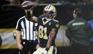 FILE - In this Aug. 30, 2018, file photo, New Orleans Saints wide receiver Cameron Meredith (81) celebrates his touchdown reception in the first half of an NFL preseason football game against the Los Angeles Rams in New Orleans.  Saints coach Sean Payton says the club has released veteran wide receiver Cameron Meredith. As recently as 2016, Meredith led the Chicago Bears in receiving, with 66 catches for 888 yards. But he missed all of 2017 because of a major knee injury. (AP Photo/Bill Feig, File)