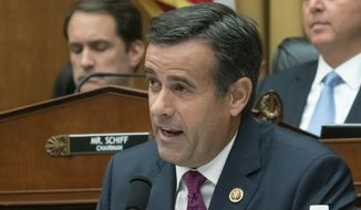 In this Wednesday, July 24, 2019 photo, Rep. John Ratcliffe, R-Texas, a member of the House Intelligence Committee, questions former special counsel Robert Mueller as he testifies to the House Intelligence Committee about his investigation into Russian interference in the 2016 election, on Capitol Hill in Washington. President Donald Trump announced Sunday, July 28 that he will nominate Rep. Ratcliffe to replace Director of National Intelligence Dan Coats, who is leaving his job next month. (AP Photo/J. Scott Applewhite)