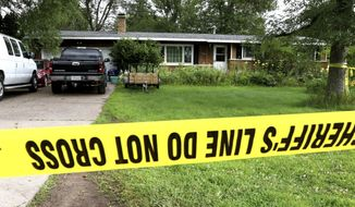 Police tape blocks off a home Monday, July 29, 2019, in Lake Hallie, Wis., following a shooting the night before. Authorities in northwestern Wisconsin say shootings at two homes have left five people dead, including the suspected shooter, and two others injured. (Dan Reiland/The Eau Claire Leader-Telegram via AP)