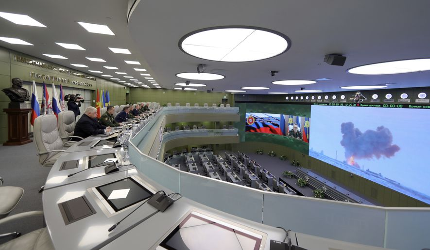 Russian Defense Minister Sergei Shoigu, fourth left, Russian President Vladimir Putin, fifth left, Chief of General Staff of Russia Valery Gerasimov, sixth left, and other top officials oversee the test launch of the Avangard hypersonic glide vehicle from the Defense Ministry's control room in Moscow, Russia, Wednesday, Dec. 26, 2018. In the test, the Avangard was launched from the Dombarovskiy missile base in the southern Ural Mountains. The Kremlin says it successfully hit a designated practice target on the Kura shooting range on Kamchatka, 6,000 kilometers (3,700 miles) away. (Mikhail Klimentyev, Sputnik, Kremlin Pool Photo via AP)