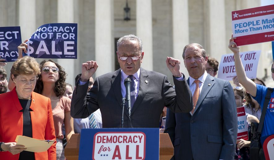 Senate Minority Leader Chuck Schumer, D-N.Y., flanked by Sen. Jeanne Shaheen, D-N.H., left, and Sen. Tom Udall, D-N.M., leads a group of Democrats at the Supreme Court in announcing the introduction of a constitutional amendment that would overturn Citizens United v. FEC decision to get big money out of politics, at the Supreme Court in Washington, Tuesday, July 30, 2019. (AP Photo/J. Scott Applewhite)