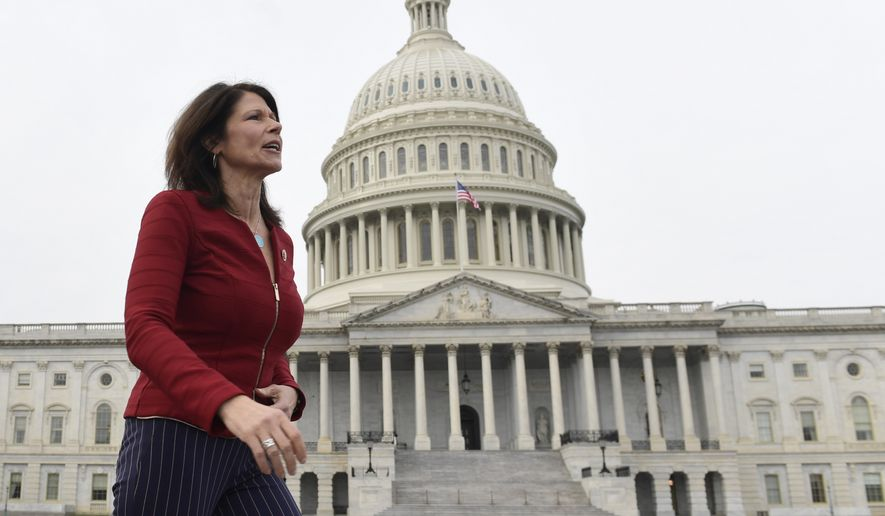 In this Jan. 4, 2019 file photo, Rep. Cheri Bustos, D-Ill., walks to a group photo with the women of the 116th Congress on Capitol Hill in Washington. A mass departure of top aides is shaking House Democrats campaign arm after Hispanic and black members of Congress complained that the staff lacked diversity. Illinois Rep. Cheri Bustos is chairwoman of the Democratic Congressional Campaign Committee. Shes issued a statement saying shed fallen short and would work to make the staff truly inclusive. (AP Photo/Susan Walsh)