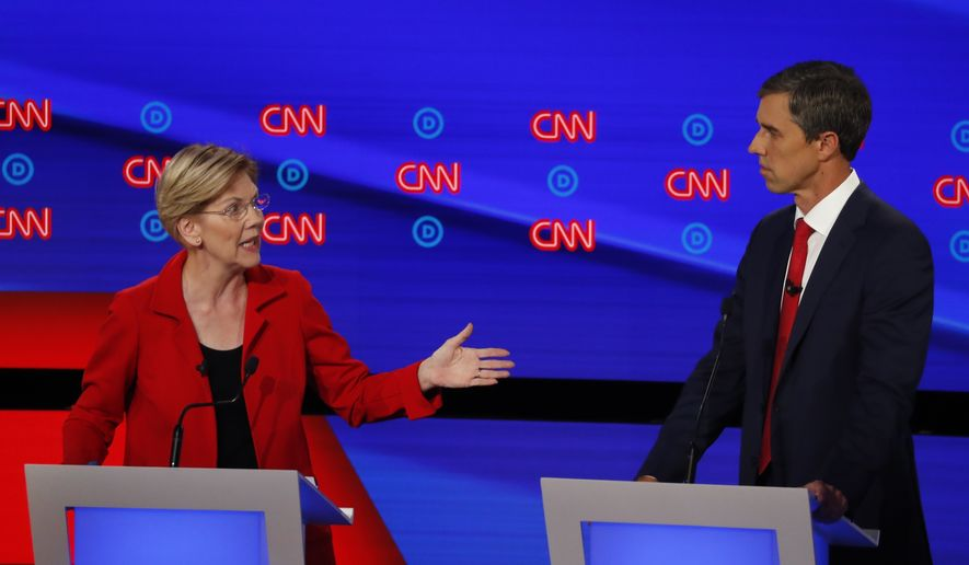 Sen. Elizabeth Warren, D-Mass., gestures to former Texas Rep. Beto O'Rourke during the first of two Democratic presidential primary debates hosted by CNN Tuesday, July 30, 2019, in the Fox Theatre in Detroit. (AP Photo/Paul Sancya) ** FILE **