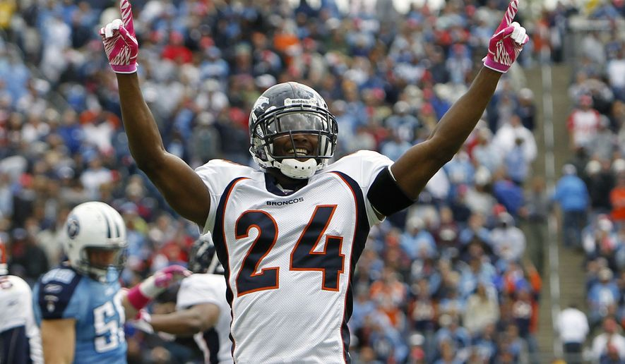FILE - In this Oct. 30, 2010, file photo, Denver Broncos defenders Champ Bailey (24) celebrates after the Broncos recovered a kickoff that the Tennessee Titans could not hang onto late in the fourth quarter of an NFL football game, in Nashville, Tenn. The Broncos went on to kick a field goal to secure their win over the Titans 26-20. Bailey will be inducted into the Pro Football Hall of Fame in Canton, Ohio on Aug. 3, 2019. (AP Photo/Mark Humphrey, File)