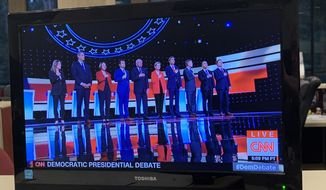 Rep. Tim Ryan of Ohio, second from left, did not put his hand over his heart during the national anthem during Tuesday night's Democratic debate. (Victor Morton/The Washington Times)
