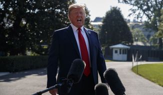 President Donald Trump talks with reporters before departing for an event to celebrate the 400th anniversary celebration of the first representative assembly at Jamestown, on the South Lawn of the White House, Tuesday, July 30, 2019, in Washington. (AP Photo/Evan Vucci)
