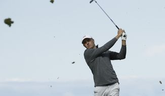 Jordan Spieth of the United States plays from the 6th tee during the third round of the British Open Golf Championships at Royal Portrush in Northern Ireland, Saturday, July 20, 2019.(AP Photo/Matt Dunham)