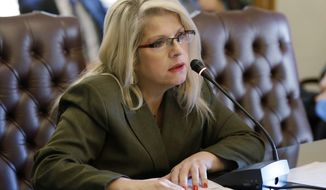 FILE - In this Jan. 28, 2015 file photo, Sen. Linda Collins-Smith, R-Pocahontas, speaks at the Arkansas state Capitol in Little Rock, Ark. Prosecutors say they plan to seek the death penalty against Rebecca Lynn O'Donnell, charged with killing former lawmaker Collins-Smith, who was found dead June 4, 2019 outside her own home. Prosecutor Henry Boyce on Tuesday, July 30 told the Arkansas Democrat-Gazette his office would formally announce its plans at an arraignment and plea hearing for O'Donnell, who's been charged with capital murder. (AP Photo/Danny Johnston, File)