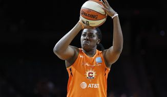 FILE - In this July 26, 2019, file photo, Connecticut Sun's Shekinna Stricklen shoots during the WNBA All-Star 3-point contest in Las Vegas. The sprint to the finish of the WNBA season gets underway Tuesday, July 30, 2019, as teams return to action after the All-Star break. Las Vegas, Washington and Connecticut sit atop the standings. (AP Photo/John Locher, File)
