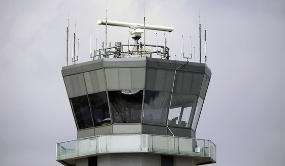 This March 12, 2013, photo shows the air traffic control tower at Chicago's Midway International Airport. (AP Photo/M. Spencer Green) ** FILE **