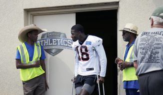 Cincinnati Bengals wide receiver A.J. Green (18) leaves practice early with an injury to his left ankle area during NFL football training camp at Welcome Stadium in Dayton, Ohio, on Saturday, July 27, 2019. (Sam Greene/The Cincinnati Enquirer via AP) **FILE**