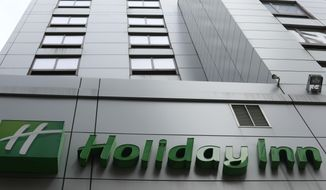 FILE - In this file photo dated March 28, 2019, the sign for a Holiday Inn in New York. The fight to save the seas from plastic waste may mean the end for mini bottles of shampoo and other toiletries, after the owner of Holiday Inn and InterContinental Hotels announced Tuesday July 30, 2019, that it will switch to bulk-size bathroom amenities across the hotel group. (AP Photo/Jenny Kane, FILE)