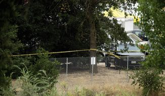 Police tape stretches behind a perimeter fence at the Gilroy Garlic Festival the morning after a deadly shooting at the food festival in Gilroy, Calif., Monday, July 29, 2019. Experts say organizers should take another look at their emergency plans in the wake of the shooting at the festival to see if they can make additional safety improvements. (AP Photo/Noah Berger)