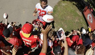 Kansas City Chiefs free safety Tyrann Mathieu signs autographs after NFL football training camp Monday, July 29, 2019, in St. Joseph, Mo. (AP Photo/Charlie Riedel)