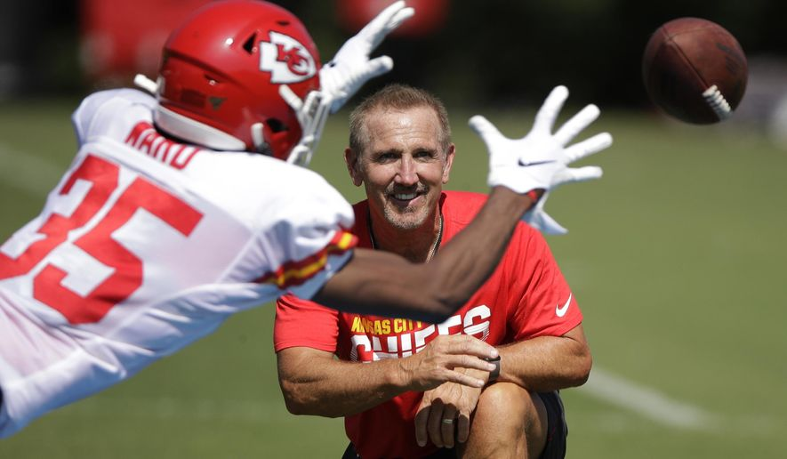 Kansas City Chiefs defensive coordinator Steve Spagnuolo watches a drill during NFL football training camp Monday, July 29, 2019, in St. Joseph, Mo. (AP Photo/Charlie Riedel)
