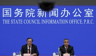 """In this file photo, Shohrat Zakir, chairman of China's Xinjiang Uighur Autonomous Region, left, speaks next to his vice chairman Alken Tuniaz during a press conference at the State Council Information Office in Beijing, Tuesday, July 30, 2019. In August 2019, Beijing announced the formation of a new """"Mountain Eagle Commando"""" unit, China's third counterterrorism commando unit, and the first to be established since the Guangzhou-based Snow Leopard Unit 17 years ago.  (AP Photo/Andy Wong) **FILE**"""