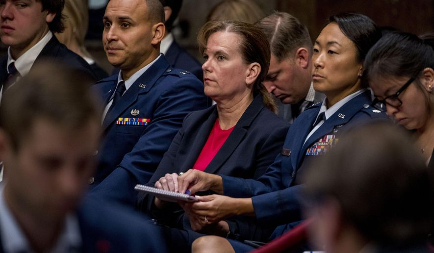 Former aide Army Col. Kathryn Spletstoser sits in the audience as Gen. John Hyten appears before the Senate Armed Services Committee on Capitol Hill in Washington, Tuesday, July 30, 2019, for his confirmation hearing to be Vice Chairman of the Joint Chiefs of Staff. (AP Photo/Andrew Harnik)