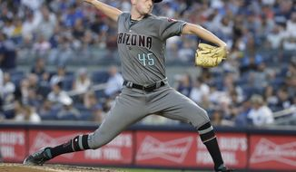 Arizona Diamondbacks' Taylor Clarke delivers a pitch during the third inning of the team's baseball game against the New York Yankees on Tuesday, July 30, 2019, in New York. (AP Photo/Frank Franklin II)