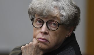 FILE - In this April 9, 2019 file photo, former Michigan State University president Lou Anna Simon appears in court in Charlotte, Mich. Simon, accused of lying about her knowledge of allegations against sports doctor Larry Nassar is getting about $2.5 million as part of a retirement package in an announcement by the school Tuesday, July 30, 2019 with Simon's retirement effective Aug. 31. She resigned last year amid pressure and has denied any cover-up. (Matthew Dae Smith/Lansing State Journal via AP, File)