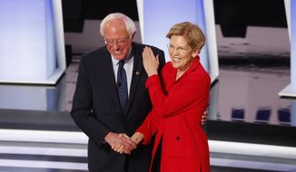 Sen. Bernie Sanders, I-Vt., and Sen. Elizabeth Warren, D-Mass., greet each other before the first of two Democratic presidential primary debates hosted by CNN Tuesday, July 30, 2019, in the Fox Theatre in Detroit. (AP Photo/Paul Sancya) ** FILE **