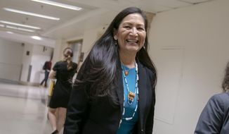 FILE - This April 3, 2019, file photo shows Rep. Deb Haaland, D-N.M., one of the first Native American woman elected to Congress, on Capitol Hill in Washington. Haaland announced Tuesday, July 30, she was endorsing U.S. Sen. Elizabeth Warren, D-Massachusetts, for president. (AP Photo/J. Scott Applewhite, File)